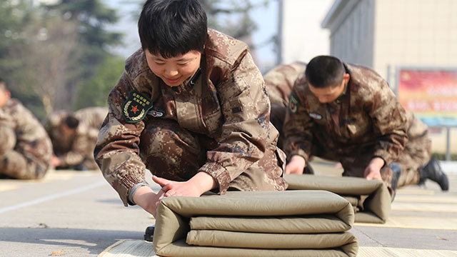 Recruits in quilt-folding competition