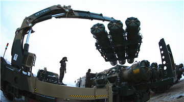 Soldiers load surface-to-air missiles