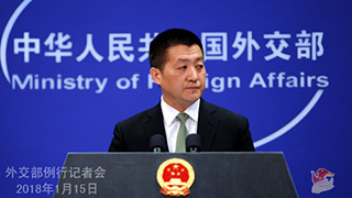 China says it pursues peaceful development , disputing