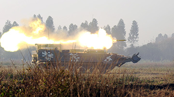 Amphibious assault vehicles fire obstacle-breaching shells