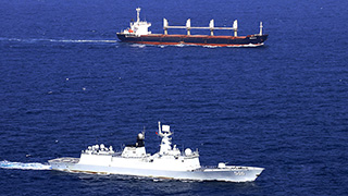 Chinese naval frigate escorts merchant ship of UNWFP