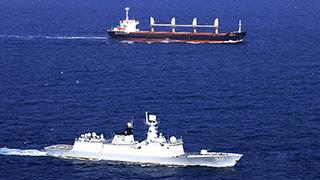 Chinese naval frigate escorts merchant ship of UNWFP