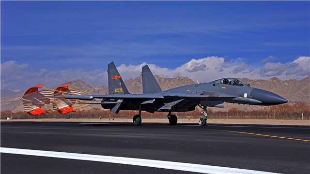 Fighter jets conduct aerial combat training over high-plateau