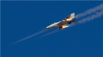 J-7 fighter jet fires rockets