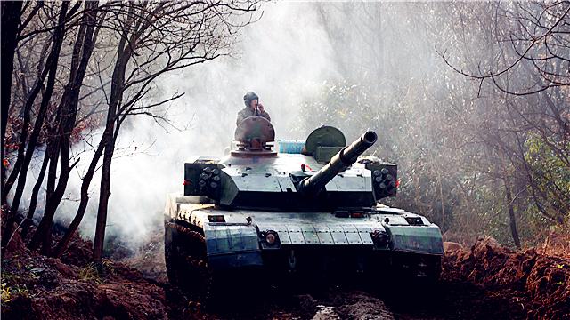 Type-96 main battle tanks cross muddy trench
