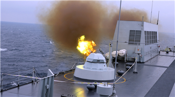 Landing ship Changbaishan fires close-in weapons system in South China Sea