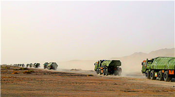 Military truck convoy in long-distance maneuver