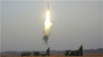 HQ-9 anti-aircraft missiles flare the sky