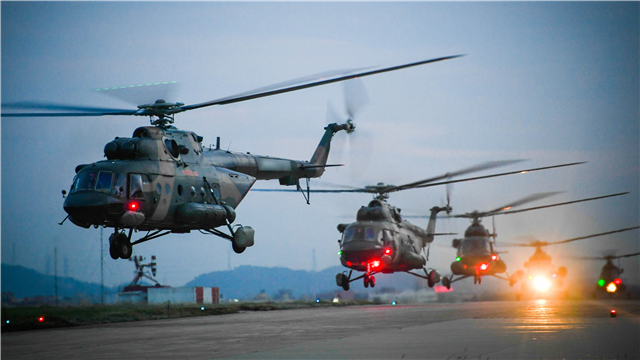 Multi-type helicopters lift off at night
