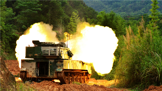 PLZ-07 122mm self-propelled howitzer system fires at targets