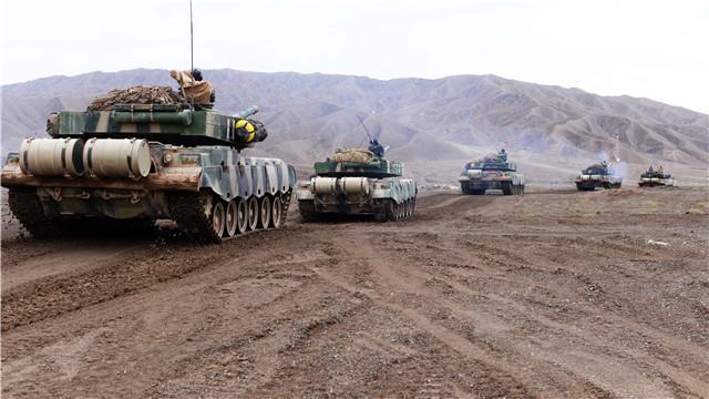 Type 96A main battle tanks move at mountainous area