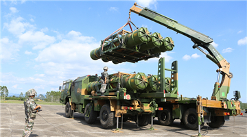 Female soldiers load HQ-16 missiles