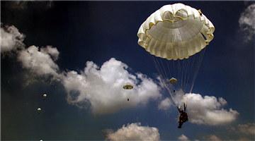 Paratroopers practice parachuting skills