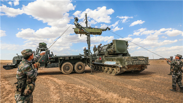 Soldiers practice loading HQ-16 and Tor missiles