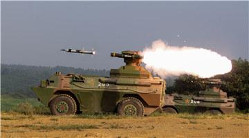Artillerymen fire PCL-09 122mm self-propelled howitzer system