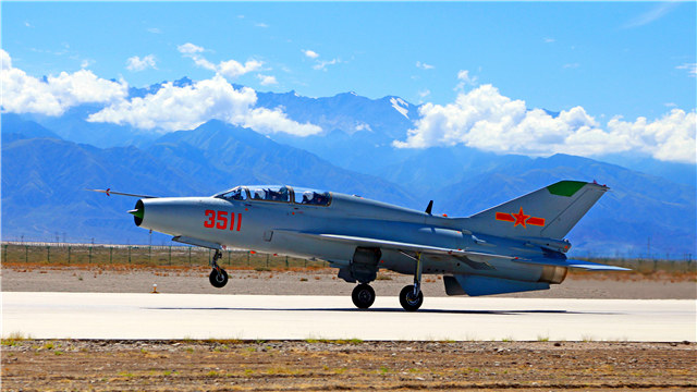 Fighter trainer airplanes fly over Qilian Mountains