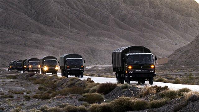 Military vehicles en route to Qilian Mountains