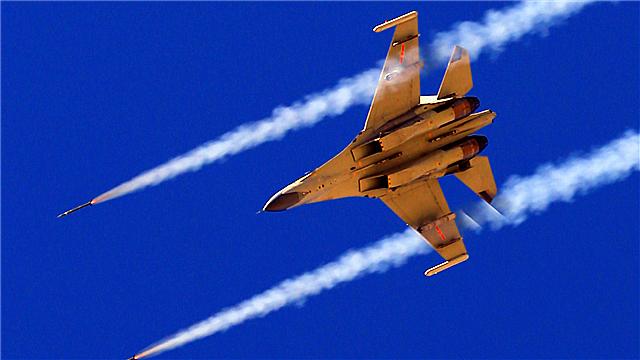 J-11 fighter jet fires at ground targets