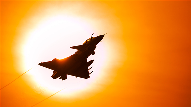 J-10 fighter jet flies past sun