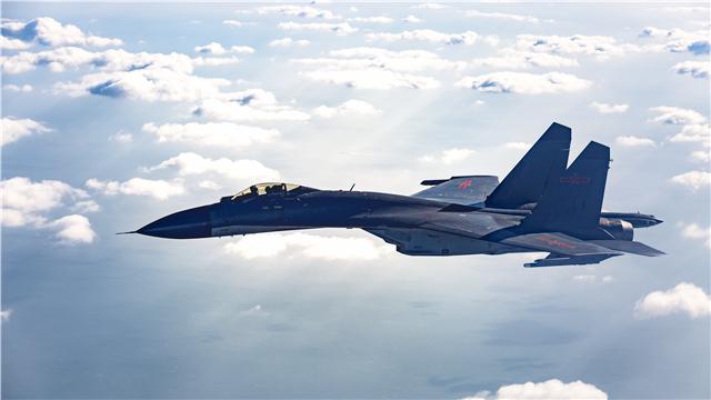 J-11B fighter jet flies above clouds