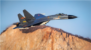 J-11B fighter jet flies through valleys