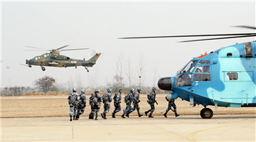 Soldiers fast-rope from transport helicopter
