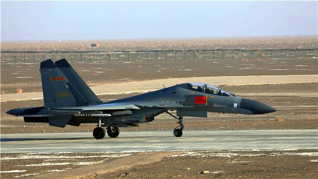J-11 fighter jets train in desert area