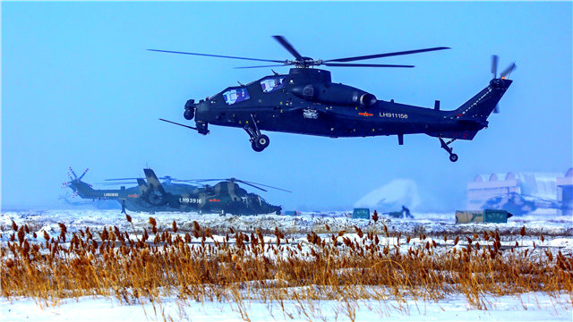 Attack and transport helicopters conduct training in Xinjiang