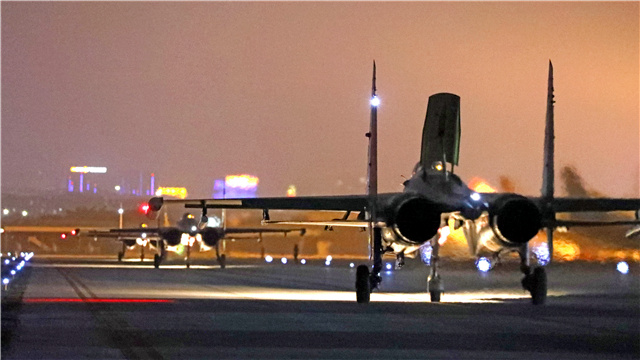 Fighter jets taxi in line on the runway before takeoff