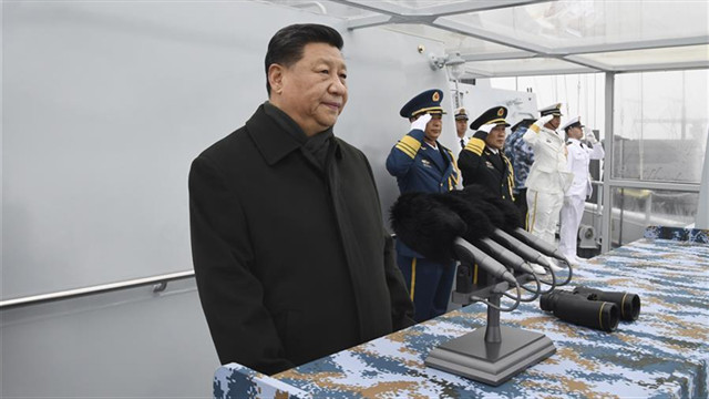 Xi reviews multinational fleet, champions maritime community with shared future