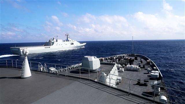 Amphibious dock landing ships release jamming shells