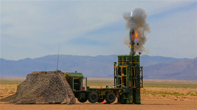 Air-defense missile system fires at targets in desert