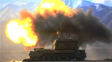Gun-howitzer spits fire against mock targets