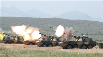 Wheeled self-propelled howitzer systems fire 122mm shells