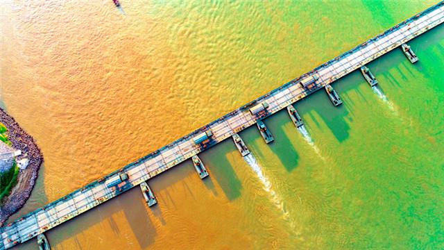 Soldiers engage in pontoon bridge building