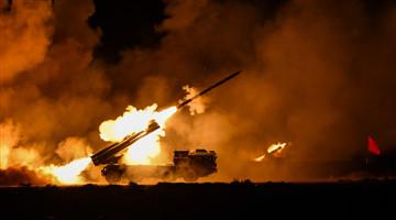 Artillery battery fires rockets at night