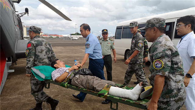 PLA's Peace Train medical team escorts 3 injured Chinese back home