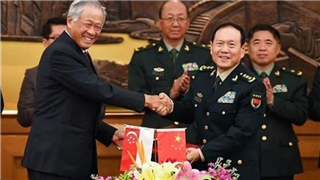 China and Singapore sign agreement to boost defense cooperation
