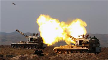 Gun-howitzer systems spit fires