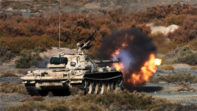 Tanks fire main guns down range