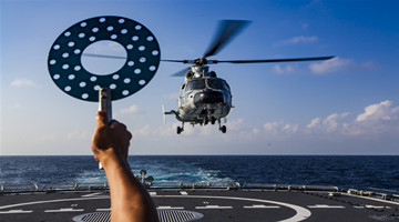 Guided-missile destroyer conducts real combat training exercise