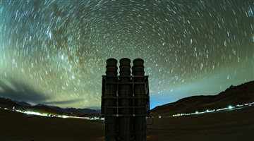 Air-defense missiles stand sheer under spectacular night sky