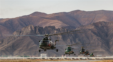 Transport helicopters fly in plateau area