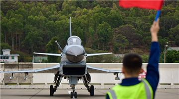 Ground crews use flag signals to guide fighters