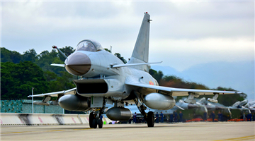 Fighter jets taxi on tarmac before takeoff