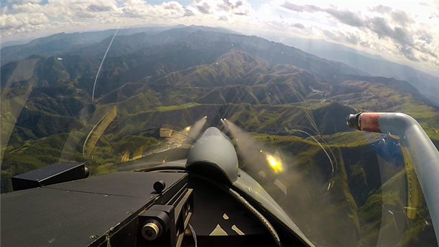 Pilots manipulate fighter jets in live-fire training