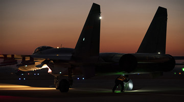 Fighter jets rest on tarmac before round-the-clock flight