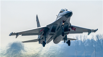 Maintenance checks on fighter jets in north China