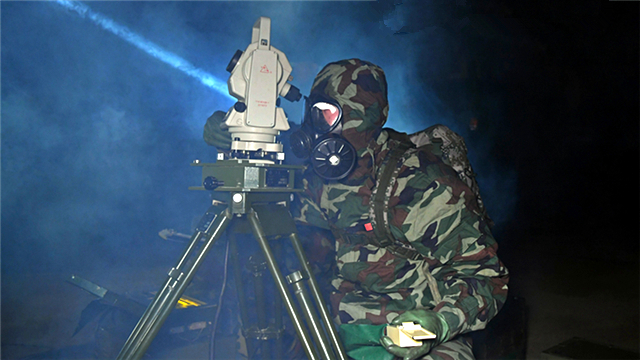 Rocket force soldiers erect ballistic missile system at night