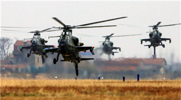 Attack helicopters lift off from parking apron